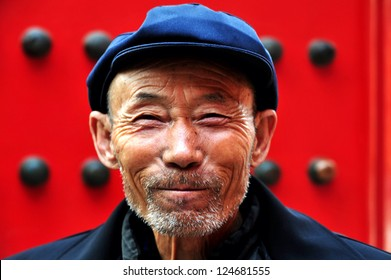 BEIJING - MARCH 11 2009:Portrait of a happy active senior adult Chinese man visiting at the Forbidden City in Beijing, China. The average life expectancy among Chinese men is 72 years