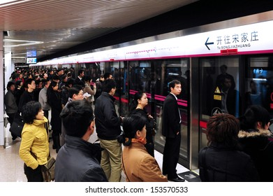 BEIJING - MARCH 18 2009:Passengers on platform waits to Beijing subway.During  2019–20 coronavirus outbreak the Chines government closed tourist attractions to prevent mass gatherings.
