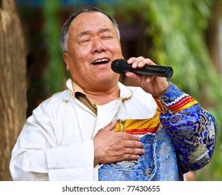 """BEIJING- MAY 16: An old singer from Menggu race of China performs with the traditional songs from Menggu race in the """"Star of Campo"""" public party in Zizhuyuan, Beijing, China, on May 16, 2011."""
