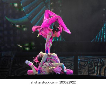 BEIJING - MAY 6: Beijing Acrobatics Troupe artists perform at the famous Chaoyang Theatre on May 6, 2012, in Beijing, China.