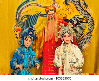 """BEIJING - MAY 7: Actors of the Beijing Opera Troupe perform the famous story """"White Snake"""" at the Huguang Theatre on May 7, 2012, in Beijing, China."""