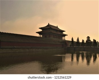BEIJING, BEIJING MUNICIPALITY / CHINA - AUGUST 24 2010: Sunset with a part of Forbidden city Beijing