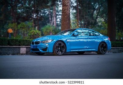 BEIJING - NOV 20, 2016: BMW M4 Coupe (F82), a high-performance version of BMW 4-series tuned by BMW's M division and the successor of the highly successful E92 M3 coupe.