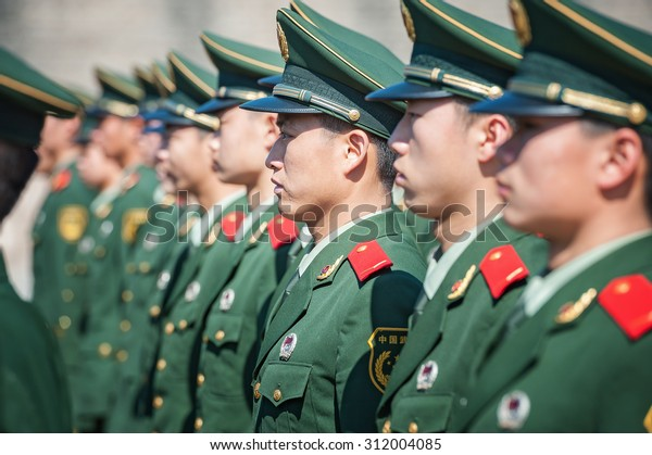 BEIJING - NOV 8: Chinese soldiers attend a parade at Tiananmen square on November 8, 2012 in Beijing, China. The Chinese army is the largest in the world, with a strength of around 2,285,000 soldiers.