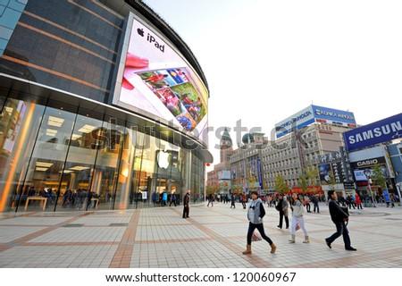 6b8f8e94cbd4 BEIJING - OCT 22  people walking in front of Apple store on Wangfujing  street on