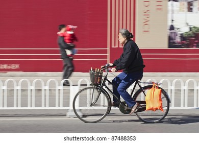 BEIJING - OCT. 25: Elderly cycles in Beijing, Oct. 25, 2011. China's elderly population (60 or older) is about 128 million, one in every ten people, the largest in the world.