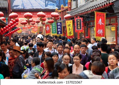 BEIJING - OCT 4: People crowd famous Wangfujing snack street during National Day holiday on Oct. 4, 2013 in Beijing, China. China's celebrates 64th anniversary of founding