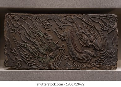 BEIJING - October 12, 2019 : Ancient Chinese Brick painting, embossed painting on brick. (There are relief paintings on the brick, not a blank brick)