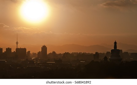 Beijing at sunset, Beihai park silhouette at dusk, White Stupa with Sunset and Mountains in Background