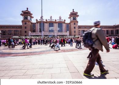 Beijing train station people walking in motion blur