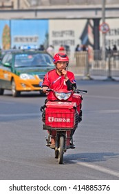 BEIJING-APRIL 28, 2016. E-bike food courier. China's growing popularity of diner delivery is the latest challenge to long-established but struggling Western companies McDonald's, KFC and Pizza Hut.
