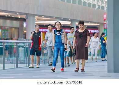 BEIJING-AUG. 2, 2015. Shoppers at Livat shopping mall. Owned by Inter Ikea Centre Group, Livat has more than 400 renowned domestic and international brands like H&M, Zara, Forever 21 and Old Navy.