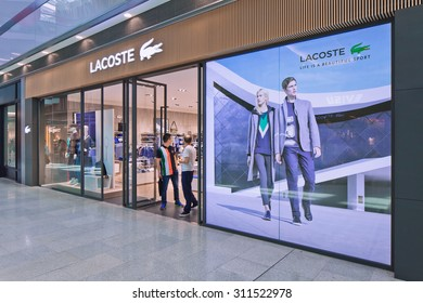 BEIJING-AUG. 21, 2015. Lacoste outlet. Lacoste is a French clothing company founded in 1933, it sells high-end clothing, footwear, perfume, leather goods, watches, eye wear, and famous polo shirts.