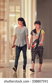 BEIJING-AUGUST 19, 2015. Girls walking in Livat shopping mall. Owned by Inter IKEA Center Group, its design is uniquely Scandinavian and houses over 400 renowned domestic and international brands.