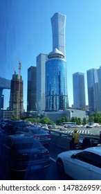 Beijing/China - April 25th, 2019: Morning jam in Beijing with skyscraper building on the background. Captured inside the bus