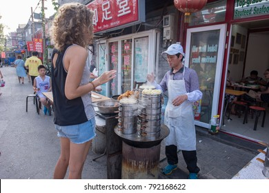 Beijing,China -August 8 ,2016 :tourist buy Steam Buns in local shop ,Beijing.