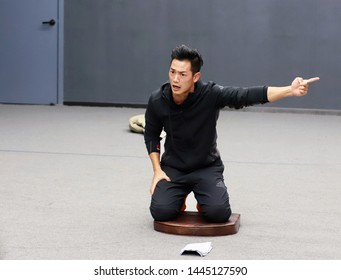beijing,China-July 5.2019: An Asian actor Goes down on his knees and making Sad statement