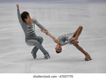 BEIJING-DEC 11: Xiaoyu Yu and Yang Jin of China perform in the Junior Pairs-Free Skating event of the ISU Grand Prix of Figure Skating Final on Dec 11, 2010 in Beijing, China.