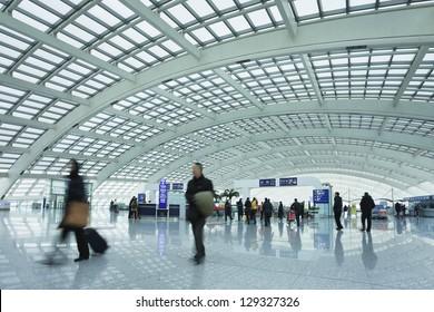 BEIJING-FEB. 21. Passengers at railway station, Beijing Capital Airport Terminal 3. The world's largest airport terminal-building complex measures 986,000 m2 floor surface. Beijing, Feb. 21, 2013.