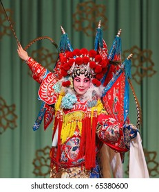 "BEIJING-FEBRUARY 19: Actors of China National Peking Opera Company perform the Peking Opera ""The Red Haired Galloping Horse"" at Meilanfang theatre on February 19, 2010 in Beijing, China"