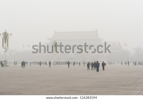 BEIJING-JANUARY 29: Tiananmen tower enveloped by the heavy fog and haze in Jan 29, 2013. Many China's cities face serious air pollution and poor air quality as the development of industry.