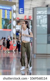 BEIJING-JULY 13, 2016. Girl running inside Beijing Capital International Airport. It is the main international airport serving the Chinese capital and one of the busiest airports in the world.