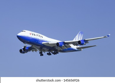 BEIJING-JULY 5. United Airlines Boeing 747-422, N178UA landing. Best-selling model of the Boeing 747 family of jet airliners. It can fly 14,200 km non-stop with maximum payload. Beijing, July 5, 2013.