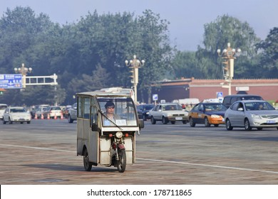 BEIJING-JUNE 1, 2013. Tricycle motor taxi at early morning. They'??re similar to Thailand Tuk Tuks, Philippines Tricycles and Vietnam Cyclo. Cost 20 RMB short ride (3 KM), 5 RMB per KM afterward.