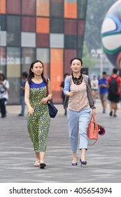 BEIJING-JUNE 25, 2014. Young women in shopping area. China's economy, boosted by middle class wealth, undergoes significant shift in consumption, driven by a new generation young prosperous consumers.