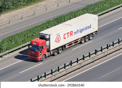 BEIJING-JUNE 30, 2015. Chinese FAW truck with a CTR refrigerator container. CTR is a Canadian company specialized in refrigeration, commercial heating, ventilation and air conditioning systems.
