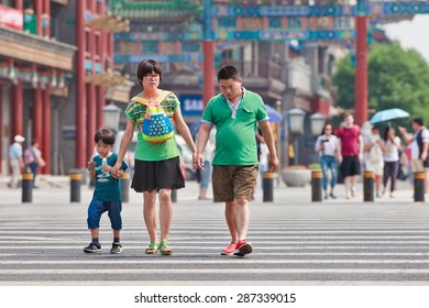 BEIJING-JUNE 9, 2015. Chinese couple with child. China's one-child policy, initiated late 1970s - early 1980s was to limit families have one child to reduce growth rate of China's enormous population.