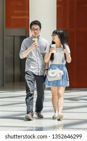 BEIJING-MAY 18, 2016. Young Chinese couple with Starbucks coffee. As of January, 2019, Starbucks had 3,521 stores in China, making it the second largest market after the US, according Statista.com.