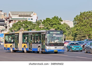 BEIJING-MAY 29, 2013. Bendi on Chang an Avenue. In 2013, the state-owned Beijing Public Transport Holdings, operated 1,020 bus routes, 22,555 buses and trolleybuses which delivered 4.63 billion rides