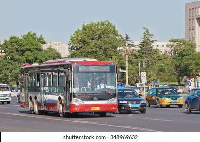 BEIJING-MAY 29, 2013. Yutong bus on Chang an Avenue. In 2013, state-owned Beijing Public Transport Holdings operated 1,020 bus routes, 22,555 buses and trolleybuses which delivered 4.63 billion rides.