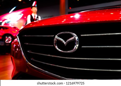 BEIJING-May 3, 2016: the exhibition sponsored by China Automobile Industry Association, consumers visit the red Mazda. MAZDA is a famous Japanese auto brand, fourth largest automobile manufacturer.