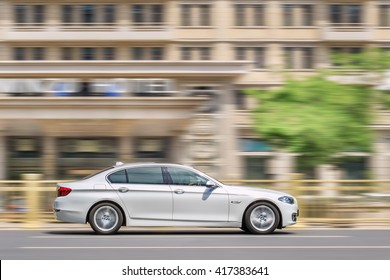 BEIJING-MAY 4, 2016. BMW 5 series L on the road. BMW sales will be hit in 2016 by cut-throat competition, slowing Chinese economy and recent government crackdown on graft and conspicuous consumption.
