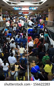BEIJING-OCT 2: Passengers crowd a subway station during National Day holiday on Oct. 2,2013 in Beijing, China. Beijing's 14 subway lines carry over 8.5 million passengers on an average weekday.