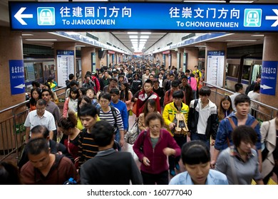 BEIJING-OCT 4: Passengers crowd a subway station during National Day holiday on Oct. 4,2013 in Beijing, China. Beijing's 14 subway lines carry over 8.5 million passengers on an average weekday.