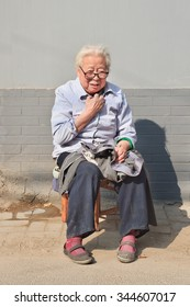 BEIJING-OCTOBER 22, 2007. Granny sit in front of her house. China's elderly population (60 years or older) is currently about 128 million, means one in every ten people, the largest in the world.