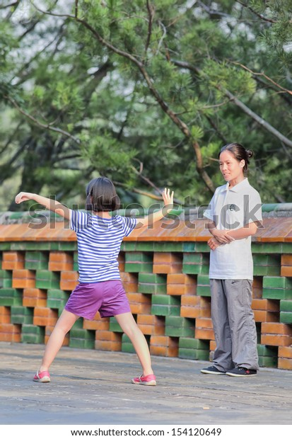 BEIJING-SEPT. 1. Nine years old Zhao Su practices Tai Chi. Tai Chi Chuan means 'Supreme Ultimate Fist', it is a martial art practiced both for self-defense and health. Beijing, Sept. 1, 2013.