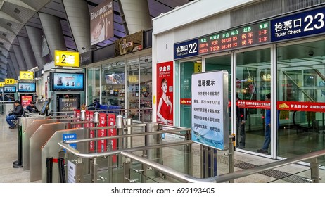 Beijng, China - Oct 31, 2016: At Beijing South (Beijingnan) Railway Station in the Fengtai District. This station serves mainly high speed trains. Image features the entrance gates.