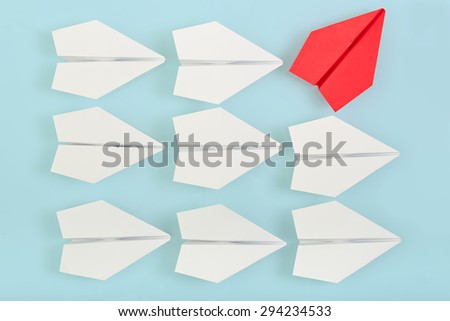 being different concept with red paper plane going in a different direction
