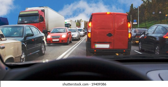 being inside passenger car within traffic jam in rush hour highway in city cars everywhere around