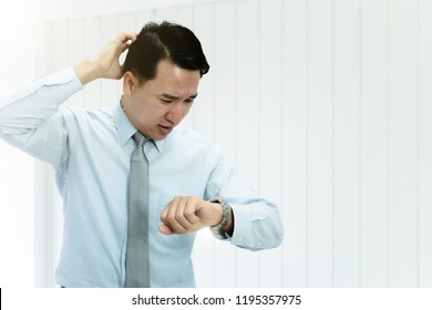 Being late to work and deadline, smart modern success professional businessman time delay and late on project. Executive angry, hurry, stress, frustrated and unsatisfied worker man lateness to office