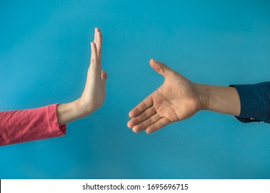 Being rude, refusing help concept. Don't shake hands to stop the spread of Coronavirus and germs concept.