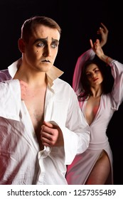 Being wildly romantic. Sexy mime man and woman act in romantic scene. Sexi couple of mime artists perform romance on stage. Couple in love with mime makeup. Theatre actors miming through body motions.