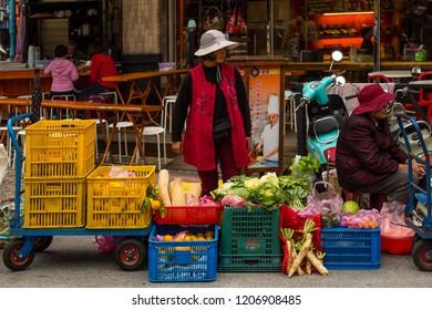 Beipu, Hsinchu County, Taiwan - December 26 2015: Street vendors of Beipu Market