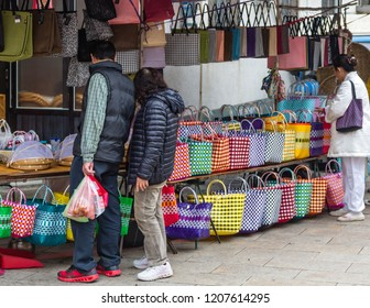 Beipu, Hsinchu County, Taiwan - December 26 2015: A market booth, selling handbags.