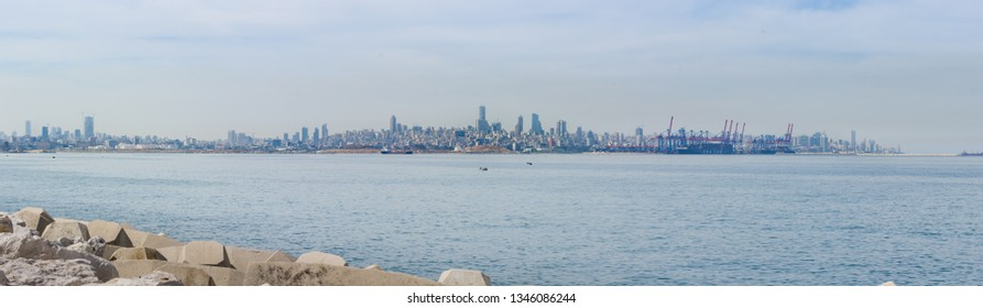 Beirut city skyline over the Mediterranean sea, with industrial port, from Antelias, Lebanon.