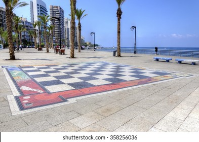 BEIRUT, LEBANON - 11 AUGUST, 2013: Corniche Beirut, in Lebanon, and the giant chess board painted on the floor. A paved street lined with palm trees perfect for a relaxing seaside promenade.
